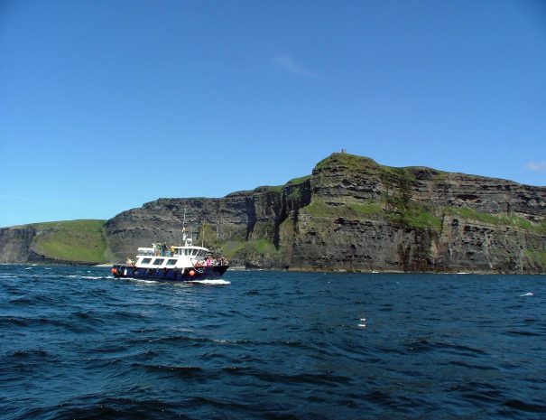 Boat tour in front of O'Brien's Tower at the Cliffs of Moher, Co. Clare